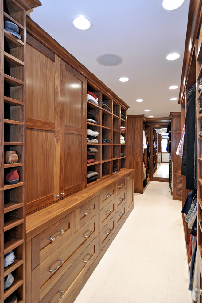 Closet - transitional porcelain tile closet idea in Calgary with shaker cabinets and medium tone wood cabinets