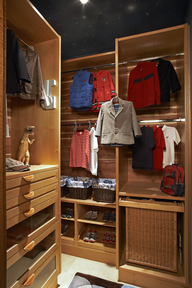 Trendy walk-in closet photo in Los Angeles with open cabinets and medium tone wood cabinets
