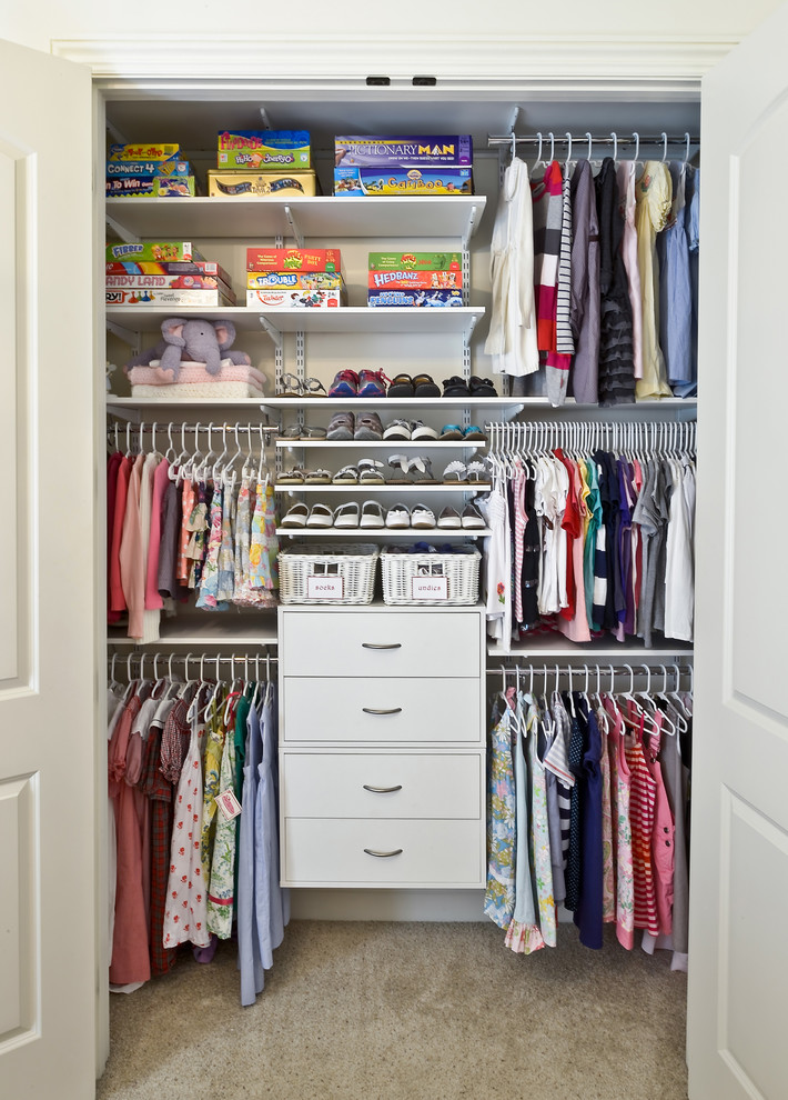 Elegant reach-in closet photo in Cincinnati with open cabinets and white cabinets