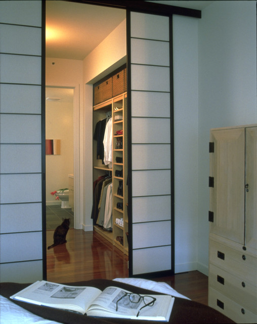 City condominium with a terrace contemporary closet for Interior designs by vickie