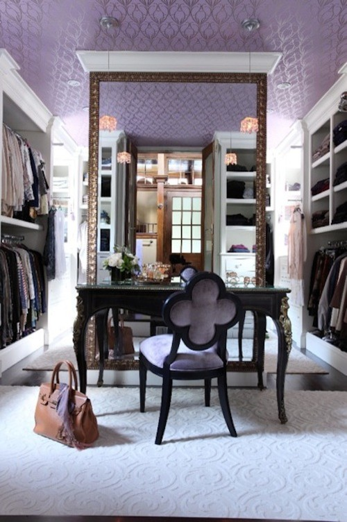 A Gothic-inspired walk-in closet featuring subtle patterns of tracery