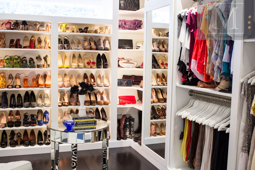 Example of a large minimalist women's walk-in closet design in Philadelphia with flat-panel cabinets and white cabinets