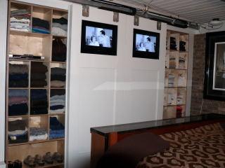 closet with moving lcd tvs contemporary-closet