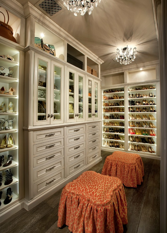 Inspiration for a timeless women's dark wood floor walk-in closet remodel in Phoenix with recessed-panel cabinets and beige cabinets