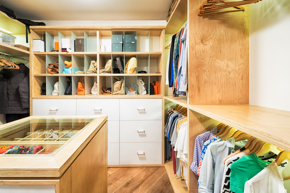 Walk-in closet - large contemporary gender-neutral medium tone wood floor walk-in closet idea in Miami with open cabinets and light wood cabinets