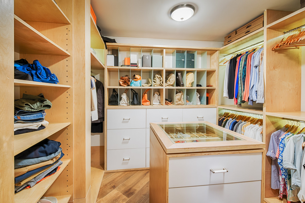 Walk-in closet - large contemporary gender-neutral medium tone wood floor walk-in closet idea in Miami with open cabinets and white cabinets
