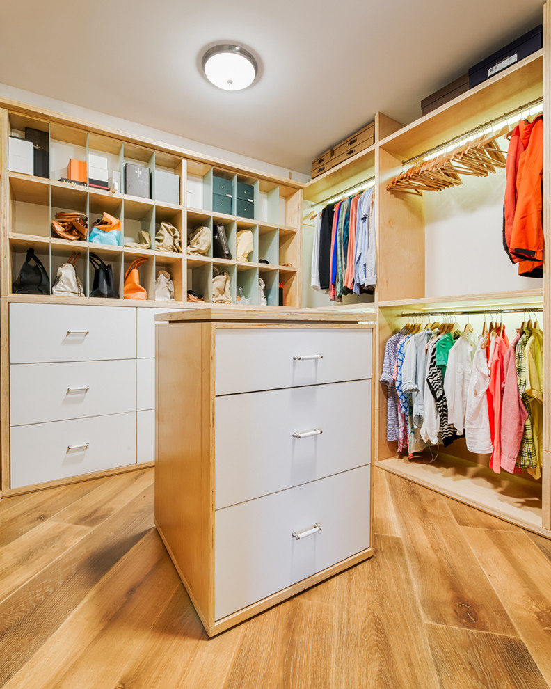 Inspiration for a large contemporary gender-neutral medium tone wood floor walk-in closet remodel in Miami with open cabinets and light wood cabinets