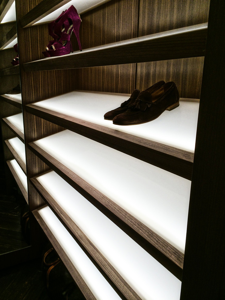 Example of a large trendy gender-neutral slate floor walk-in closet design in Miami with open cabinets and dark wood cabinets