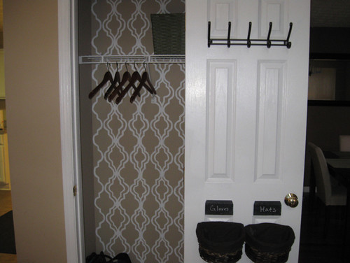 cute closet. love the wall inside, is it wallpaper or stencil