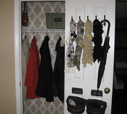 organizing a closet might include hooks on the closet door