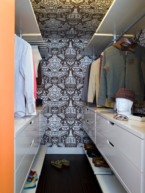 Bold wallpaper on walls and ceiling is a pretty touch in a small closet.