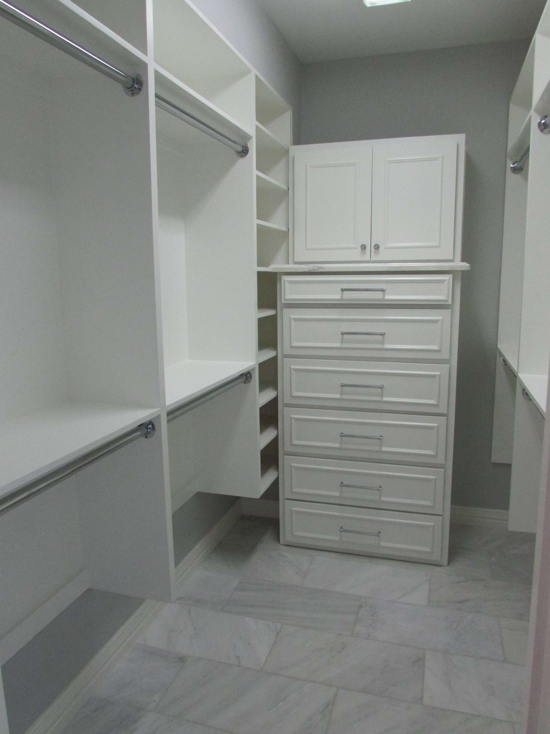 A dated Plano master bath received an updated look with a complete tear out, re-design and remodel with new custom cabinetry to include built-in dressers in closets, free standing tub with wall mounte