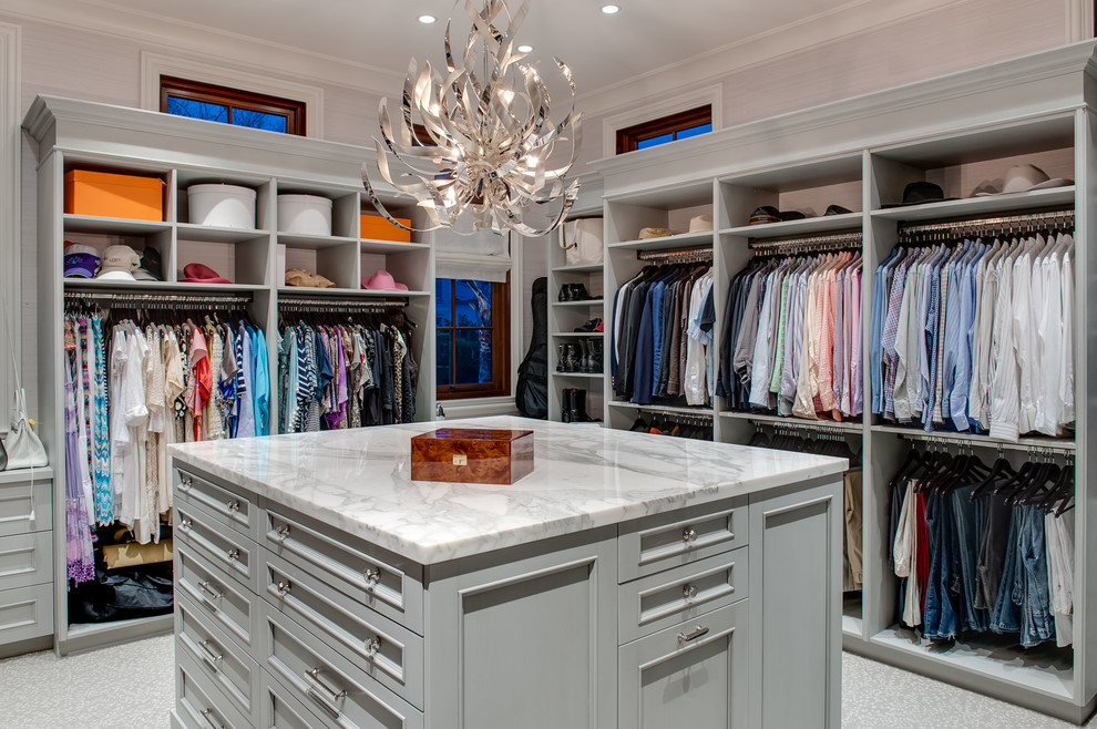Inspiration for a large transitional gender-neutral carpeted and gray floor walk-in closet remodel in Miami with gray cabinets and open cabinets