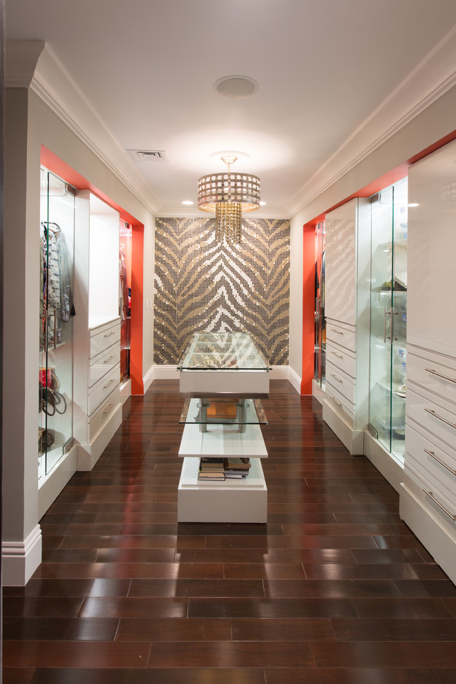 Trendy women's brown floor walk-in closet photo in Providence with white cabinets