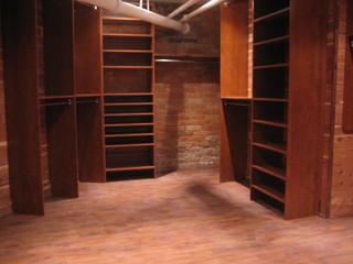 Custom Walk In Closet In Brick And Cedar Basement