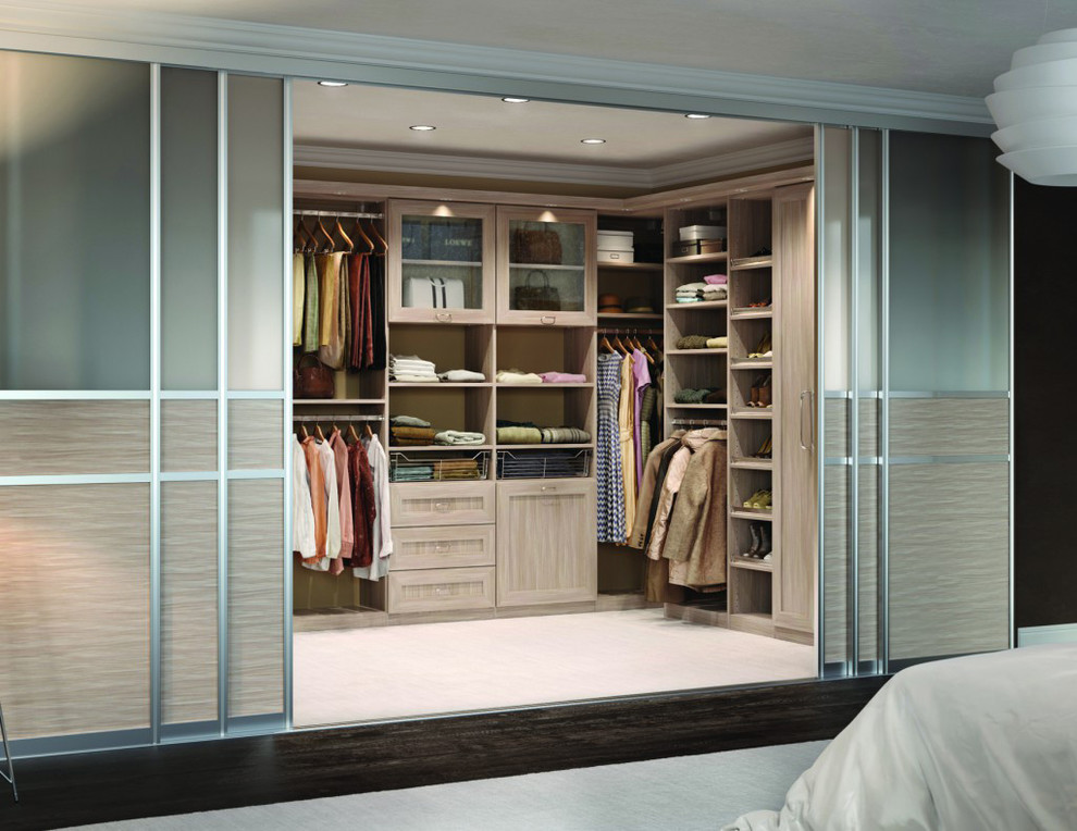 Example of a large trendy gender-neutral carpeted and beige floor walk-in closet design in Los Angeles with shaker cabinets and light wood cabinets