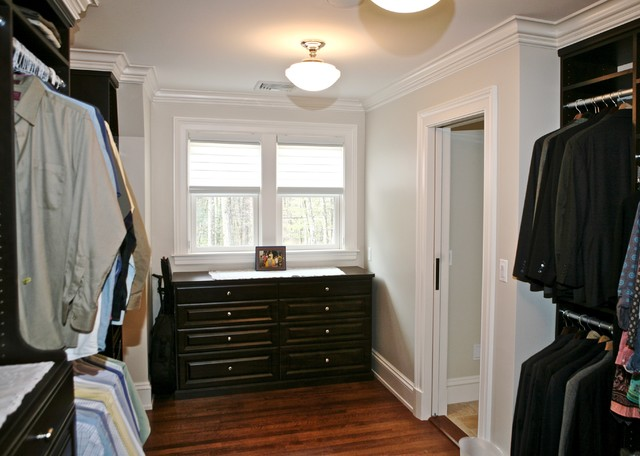 Dark wood Master walk in suite traditional-closet