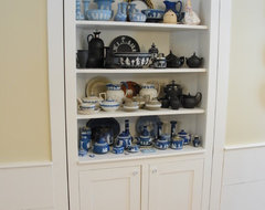 Dining room storage cupboard with a secret traditional-closet