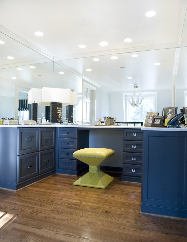 Walk-in closet - traditional walk-in closet idea in Richmond with blue cabinets
