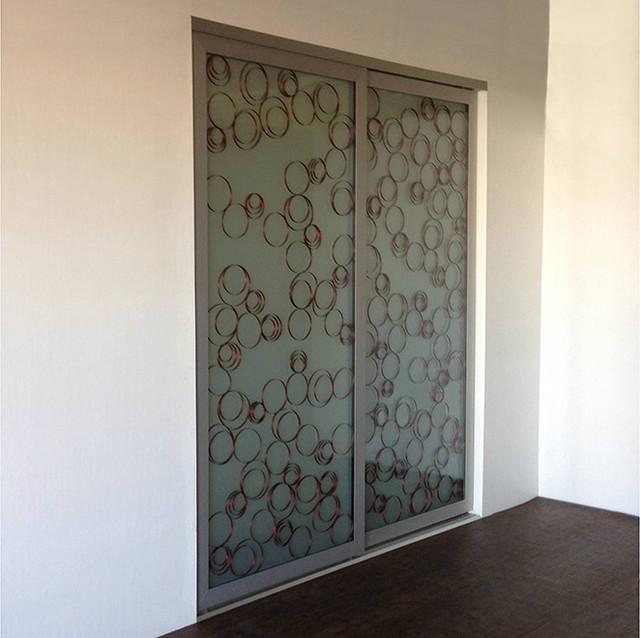 Ellipsed wood rings sliding closet doors room dividers for Closet doors los angeles