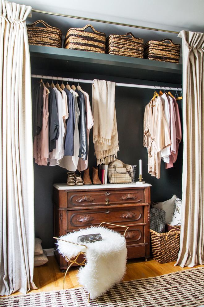 Reach-in closet - transitional medium tone wood floor reach-in closet idea in Chicago