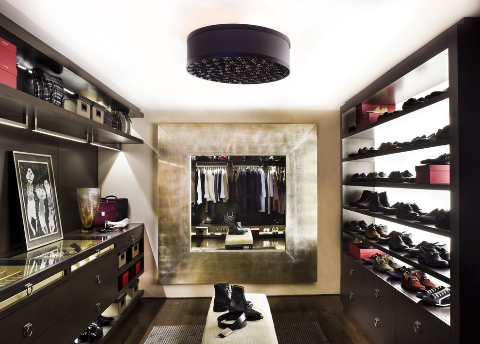 Walk-in closet - contemporary walk-in closet idea in Los Angeles with dark wood cabinets