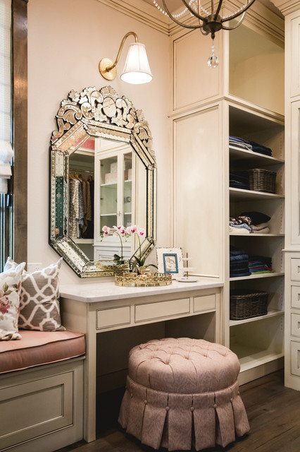 Inspiration for a timeless women's dark wood floor dressing room remodel in Oklahoma City with beaded inset cabinets and beige cabinets