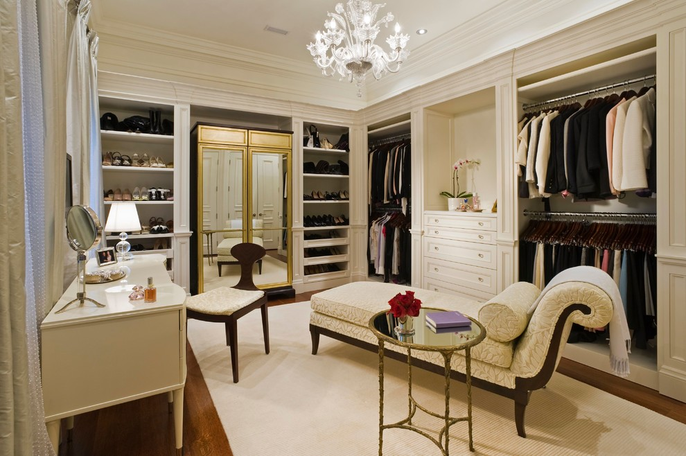 Example of a classic dressing room design in Toronto with beige cabinets