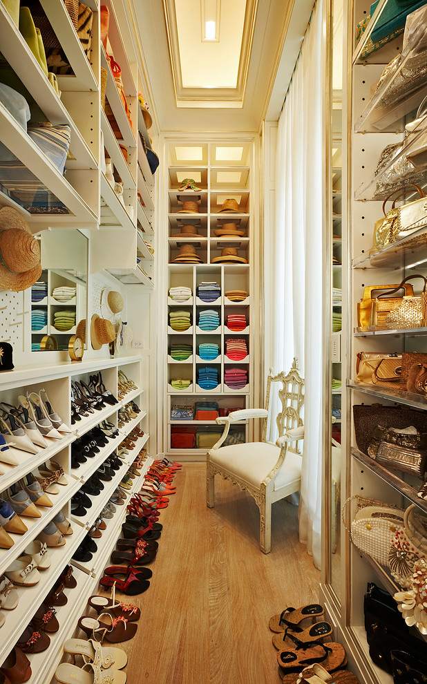Inspiration for a timeless walk-in closet remodel in New York