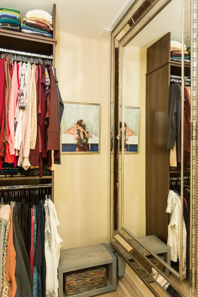 Walk-in closet - huge women's light wood floor and beige floor walk-in closet idea in Los Angeles with open cabinets and dark wood cabinets