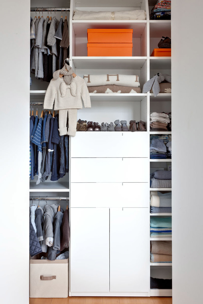 Inspiration for a contemporary reach-in closet remodel in New York with open cabinets and white cabinets