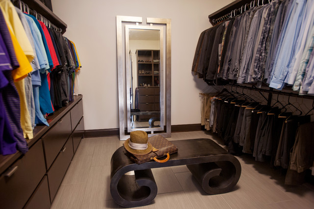Dressing room - contemporary ceramic floor dressing room idea in New Orleans with dark wood cabinets
