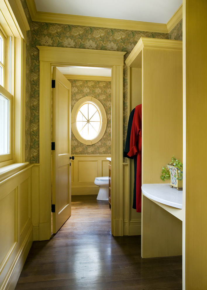 Example of a classic women's dark wood floor reach-in closet design in Boston with open cabinets and light wood cabinets