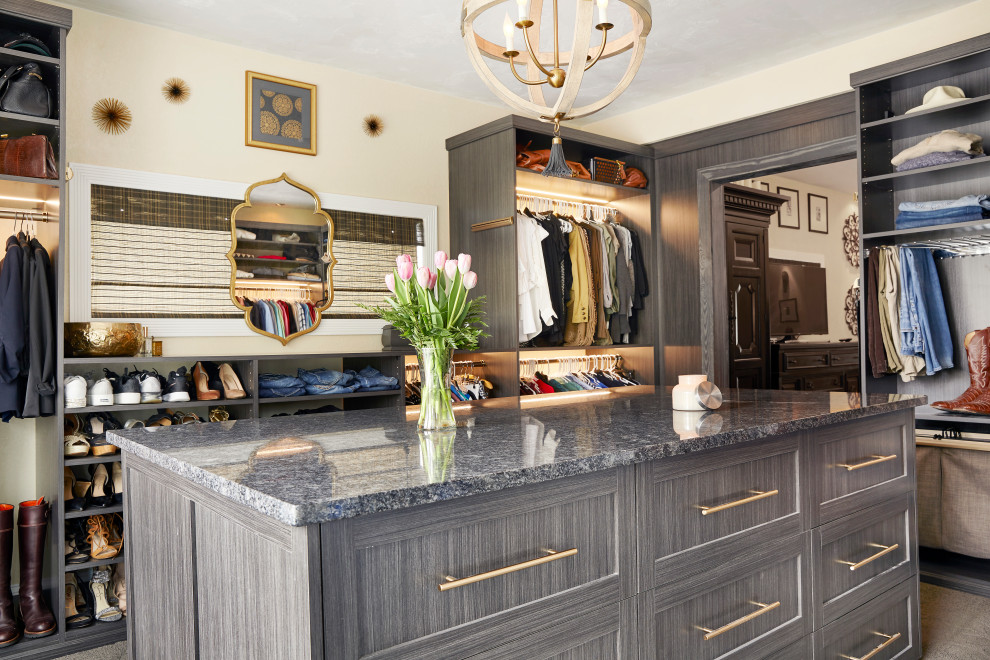 Transitional gender-neutral dressing room photo in Other with open cabinets