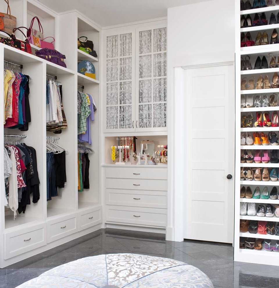 Example of a transitional women's walk-in closet design in San Diego with white cabinets and shaker cabinets