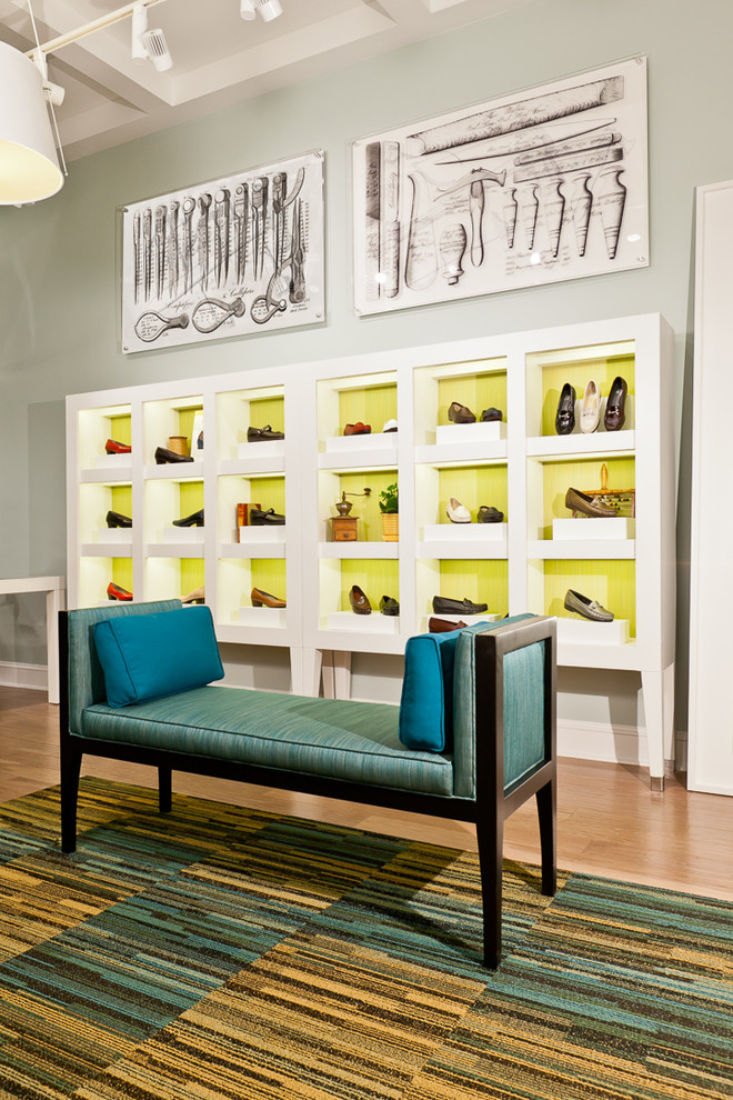 Example of a trendy light wood floor dressing room design in Austin with open cabinets and white cabinets