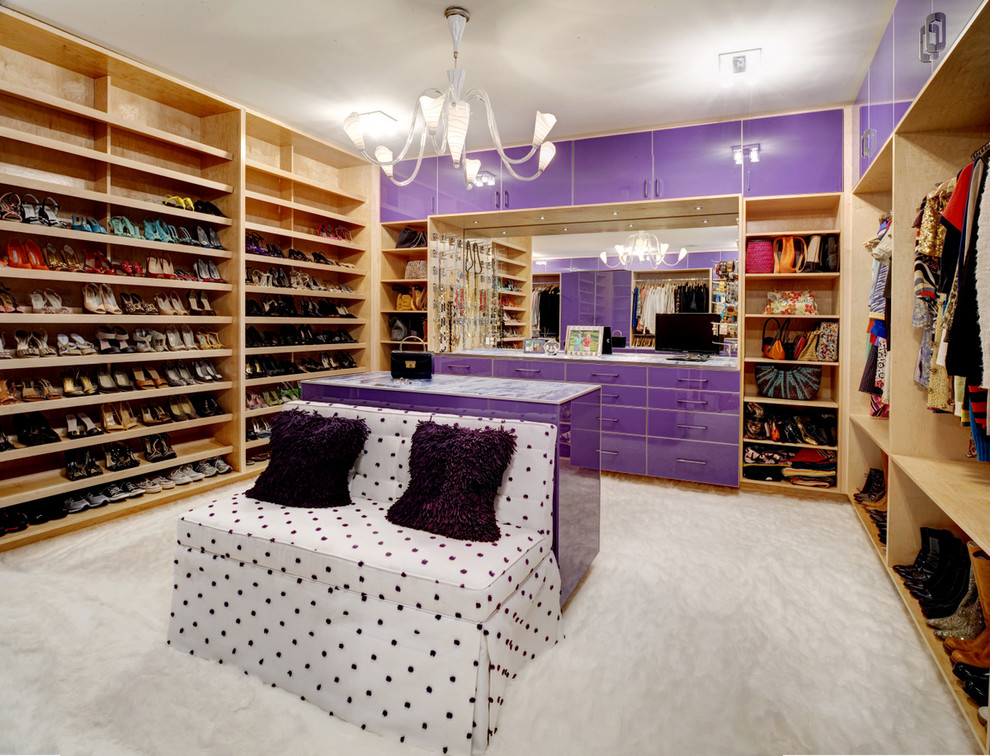 Inspiration for a contemporary women's dressing room remodel in Atlanta with open cabinets and light wood cabinets