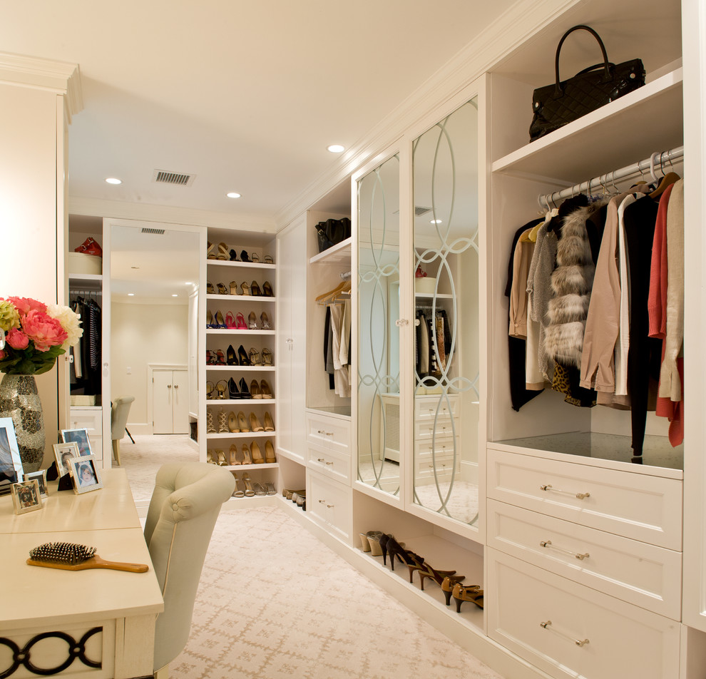 Inspiration for a large transitional gender-neutral carpeted and beige floor dressing room remodel in DC Metro with recessed-panel cabinets and white cabinets