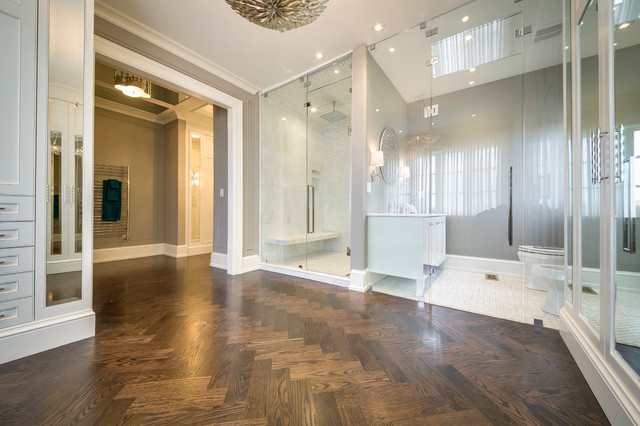 Dressing room - mid-sized modern gender-neutral medium tone wood floor dressing room idea in Toronto with white cabinets