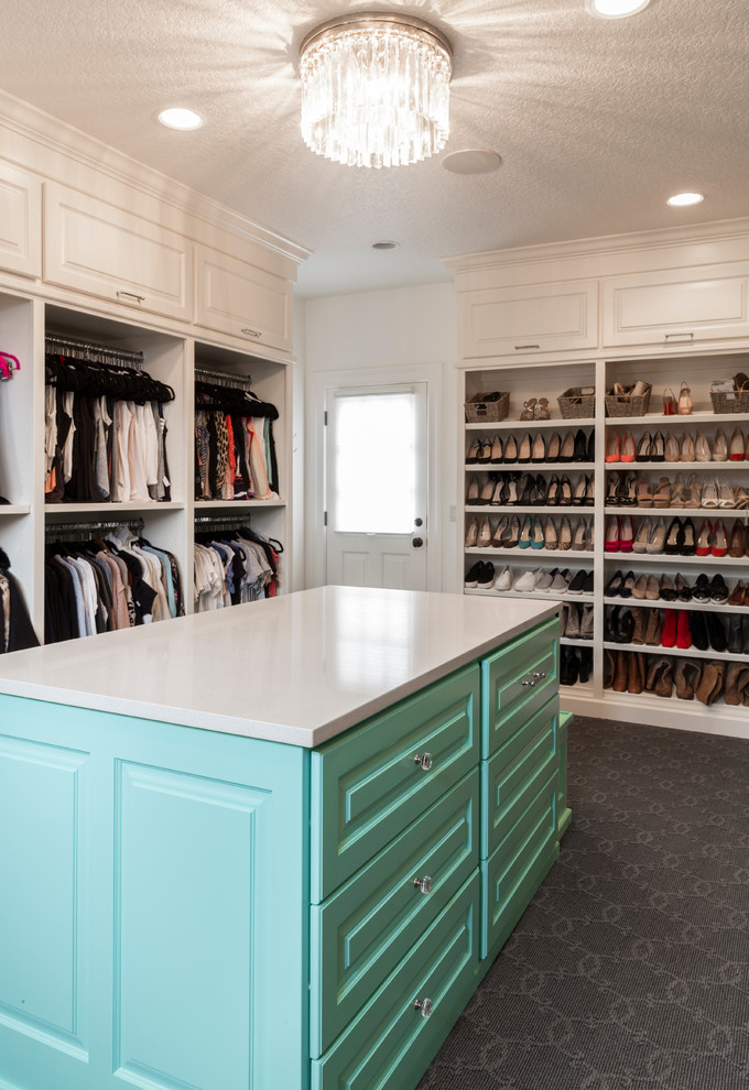 Walk-in closet - huge transitional gender-neutral carpeted and gray floor walk-in closet idea in Portland with beaded inset cabinets and blue cabinets