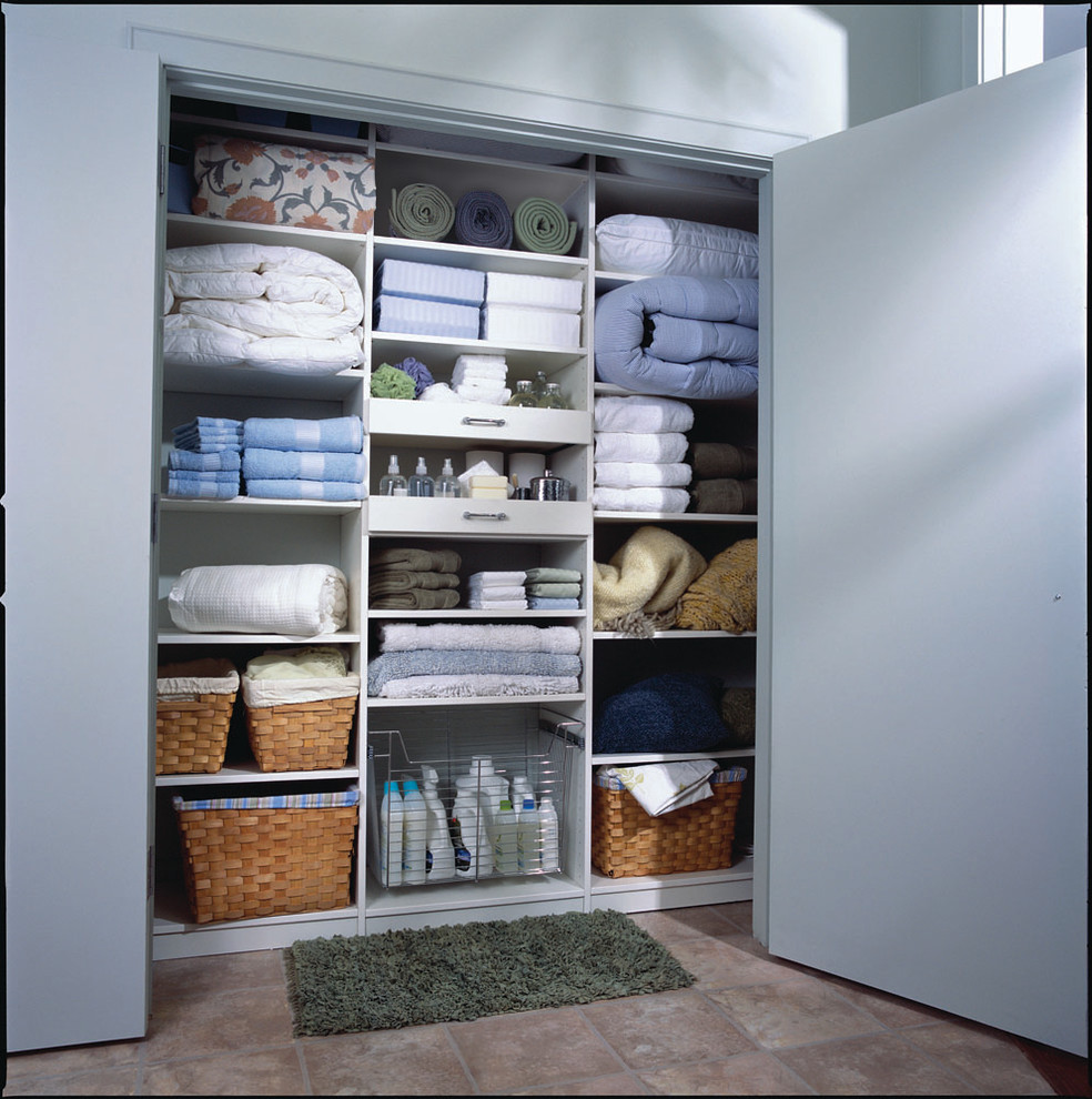 Reach-in closet - mid-sized contemporary gender-neutral ceramic floor reach-in closet idea in New York with open cabinets and white cabinets