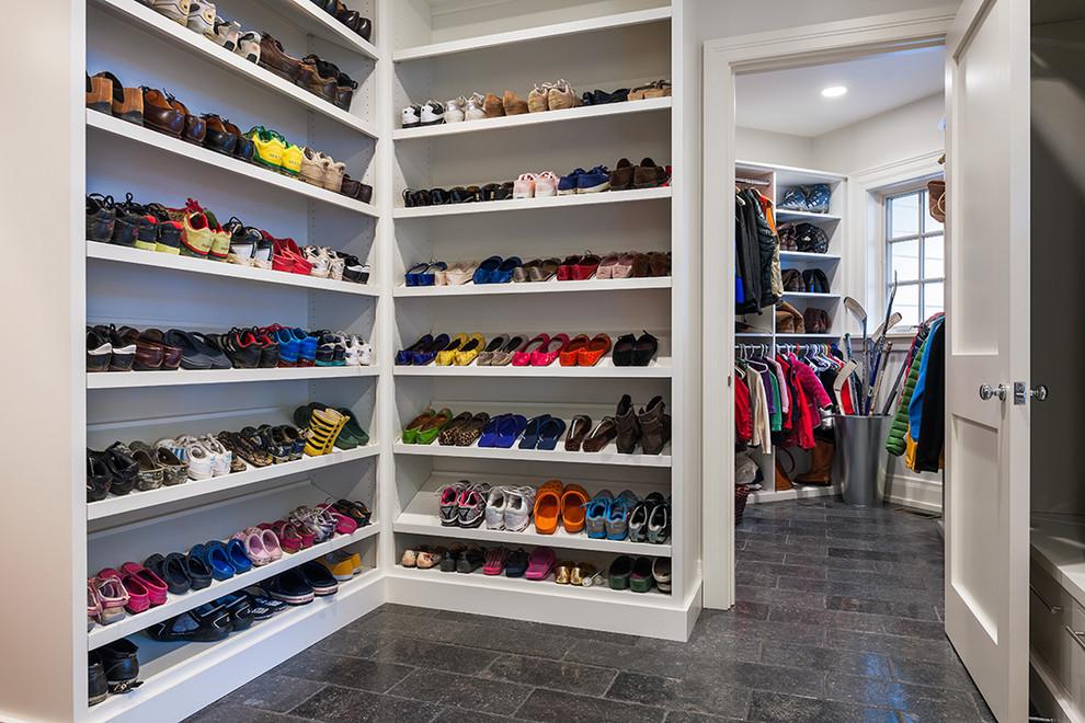 Elegant gender-neutral limestone floor walk-in closet photo in Philadelphia