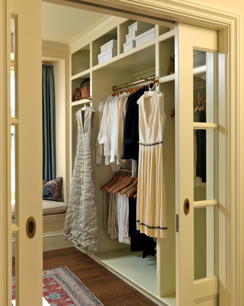 Dressing room - victorian gender-neutral medium tone wood floor and brown floor dressing room idea in Boston with open cabinets and beige cabinets