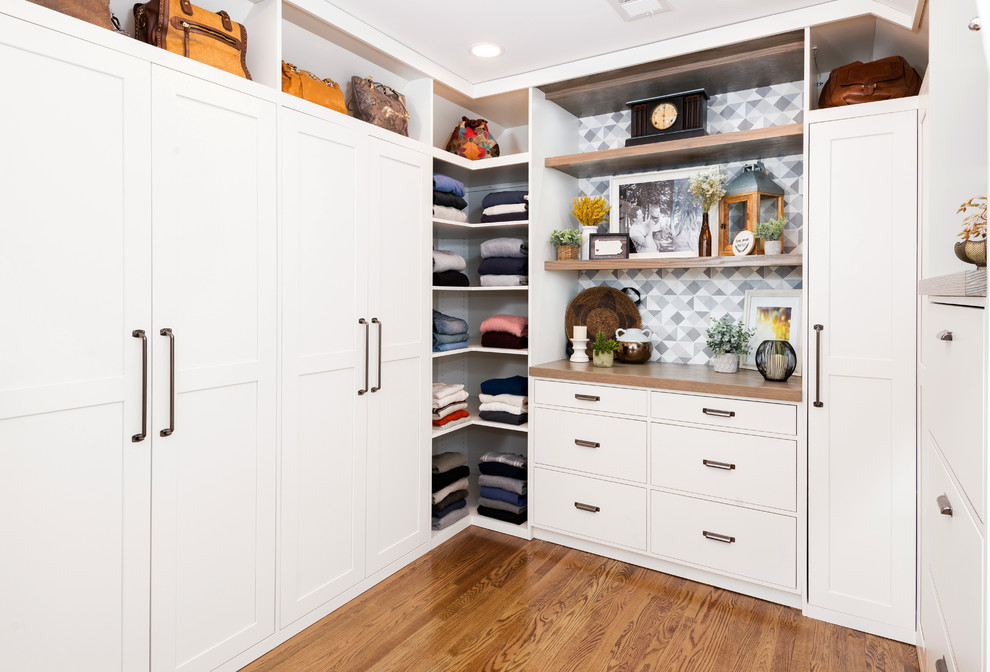 Inspiration for a large transitional gender-neutral medium tone wood floor and brown floor dressing room remodel in Other with shaker cabinets and white cabinets