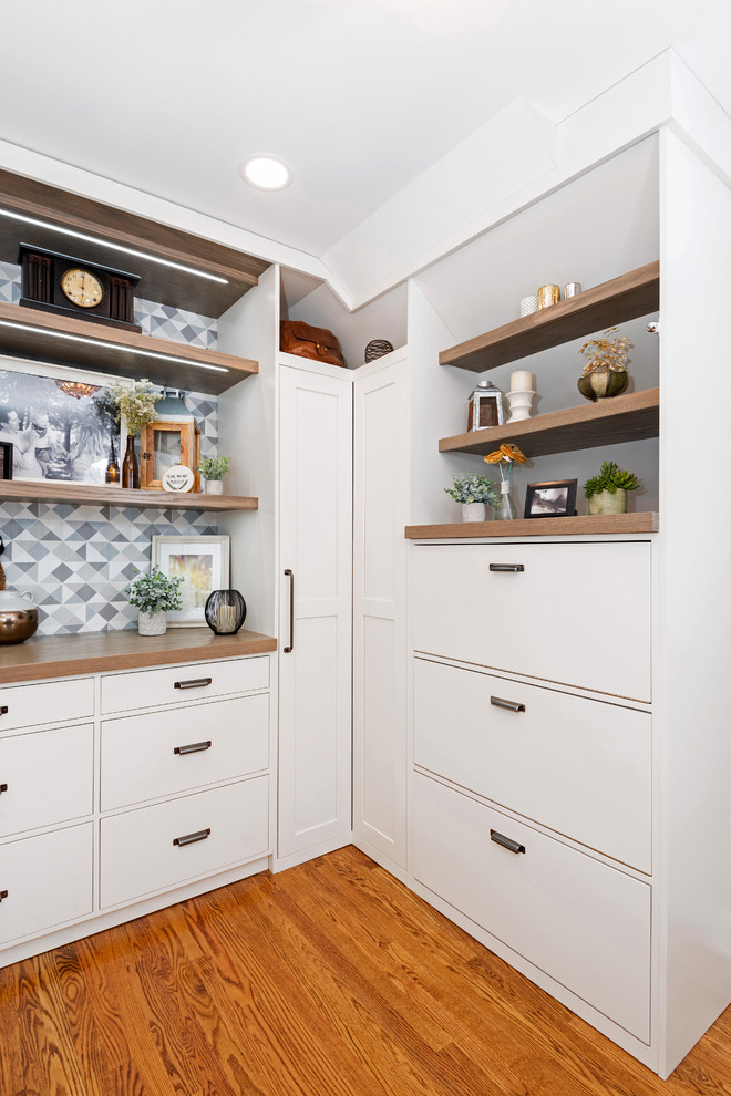 Dressing room - large transitional gender-neutral medium tone wood floor and brown floor dressing room idea in Other with shaker cabinets and white cabinets