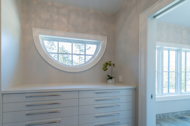 Mid-sized transitional gender-neutral dressing room photo in Toronto with flat-panel cabinets and white cabinets