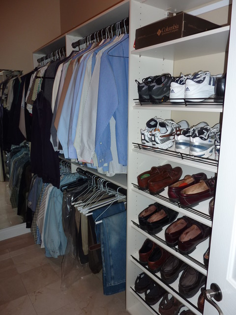 Mens Shoe Closet master closet with shoe tower and mens' hanging - eclectic