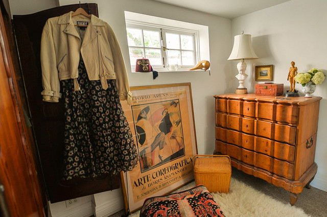 Medium sized eclectic dressing room for women in Los Angeles with carpet.