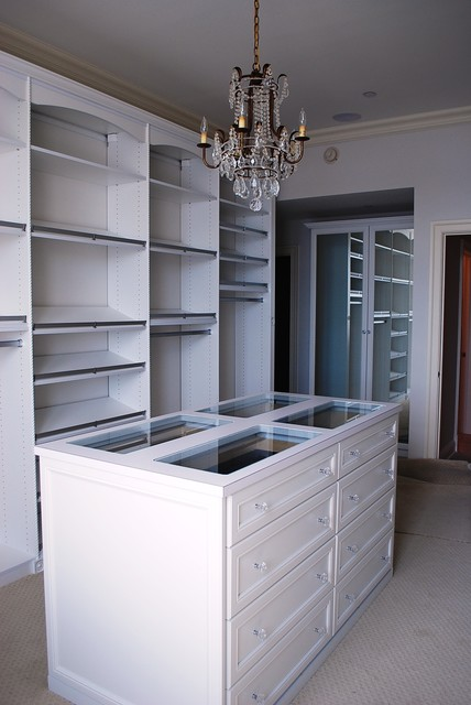 master dressing room with island shoe fences rosettes