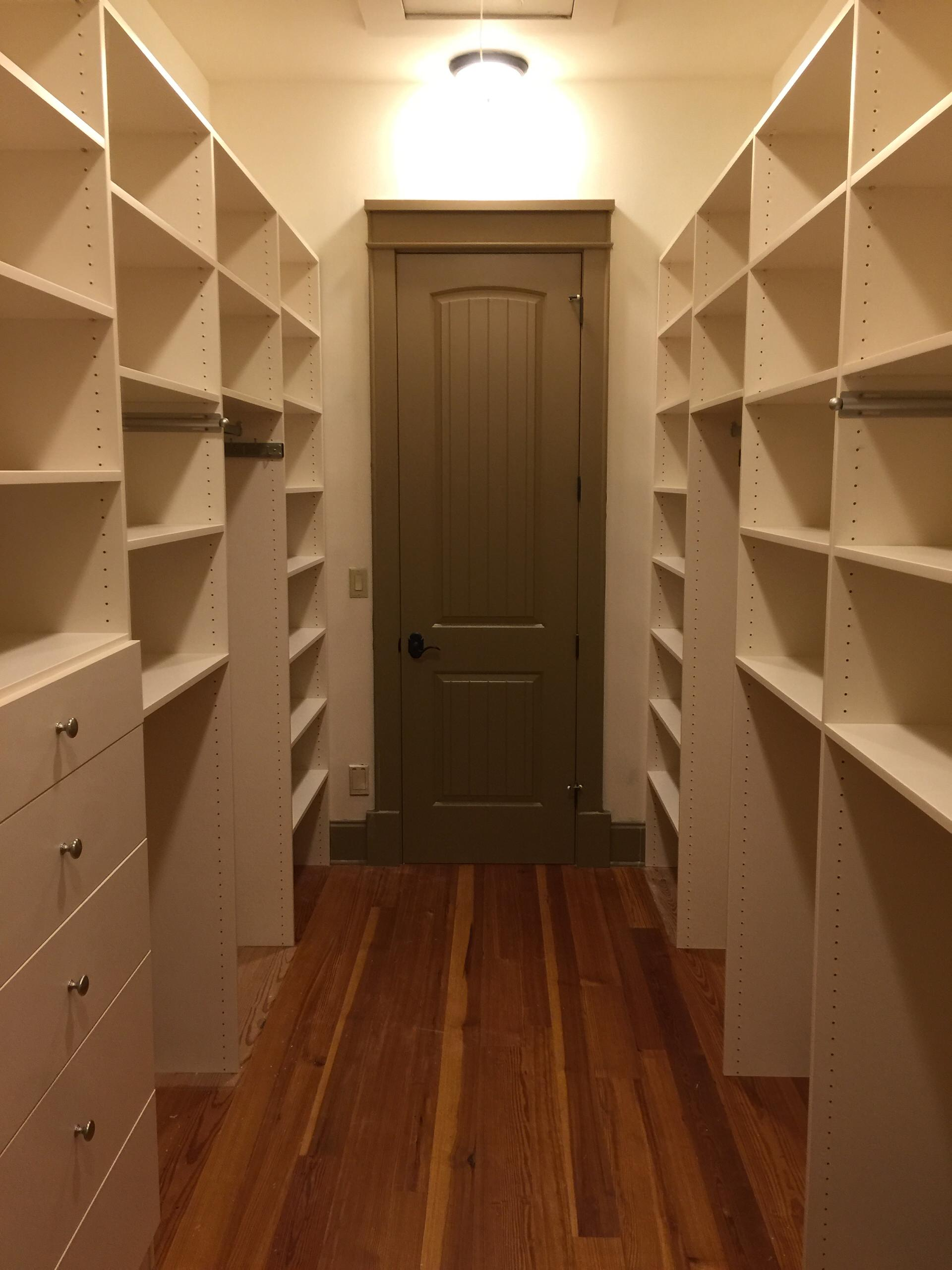 Large and beautiful spaces can make a most useful custom closets! There are adjustable shelves, single and double hanging rods, drawers and a tilt out hamper. This was installed in just one day!